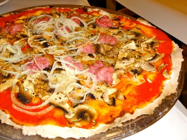 Sausage, mushroom and onion pizza at Dal Paino